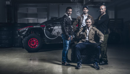 Sebastien Loeb, Cyril Despres, Carlos Sainz and Stephane Peterhansel pose for a portrait in Peugeot Sport workshop, France, on September 21, 2015